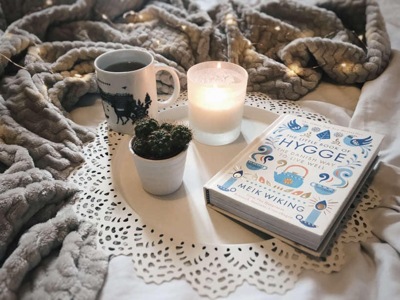 Hygge flatlay cosy atmosphere bed relaxing